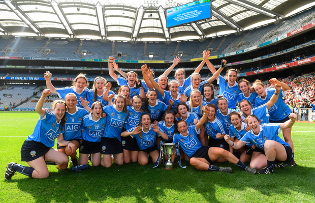 The Dublin players celebrate with the Kahtleen Mills Cup. Photo: SPORTSFILE