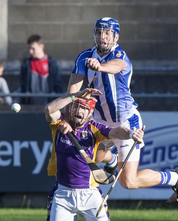 BATTLE: Ballyboden St Enda's Conal Keaney levers off Crokes defender Niall Corcoran as he attempts to field the sliotar