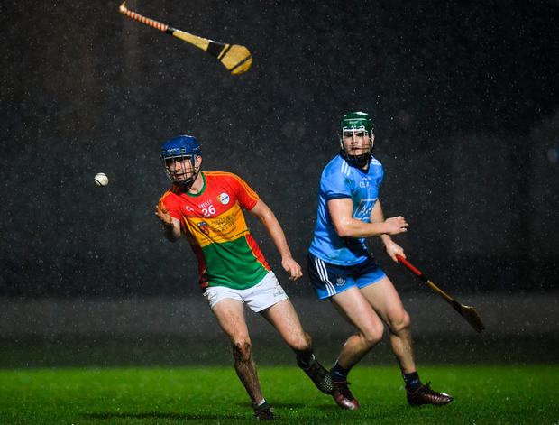 HURLEYS FLYING: Carlow's Seán Whelan loses his hurley as he turns away from Dublin's Tom Connolly during last night's Bord na Móna Walsh Cup Round 1 clash at Netwatch Cullen Park, Carlow Pic: Sportsfile