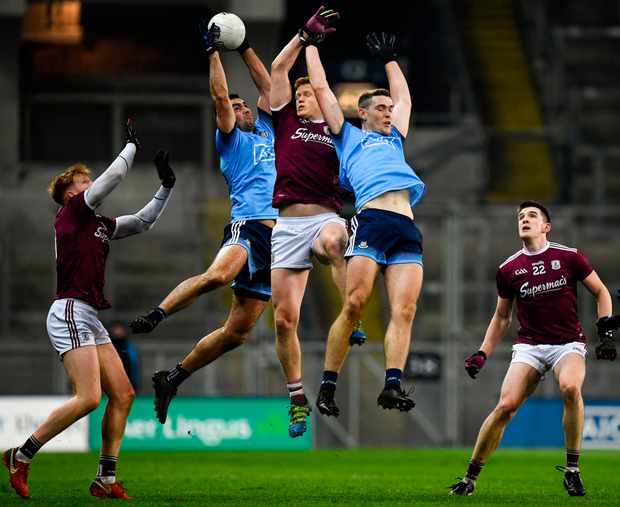 MY BALL: Dublin's James McCarthy wins possession at midfield after contesting with team-mate Brian Fenton and Galway's Kieran Duggan. Photo: SPORTSFILE