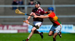 STAYING CLOSE: Padraic Mannion of Galway tries to get away from Seán Whelan of Carlow yesterday. Pic: Sportsfile