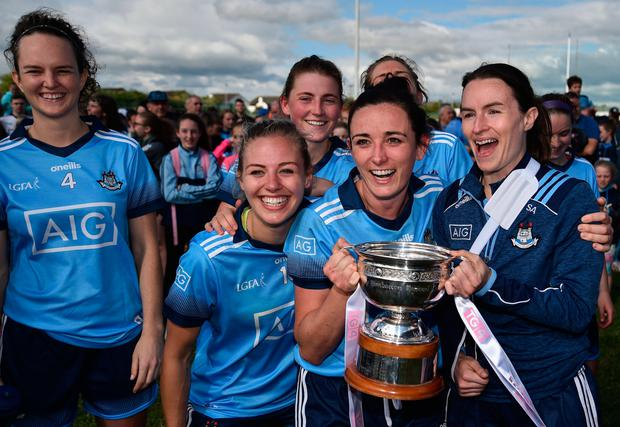 BLUE SISTERS: Dublin's Niamh McEvoy and Sinéad Aherne, who was injured early in yesterday's clash, celebrate their Leinster SFC final glory. Pic: Sportsfile