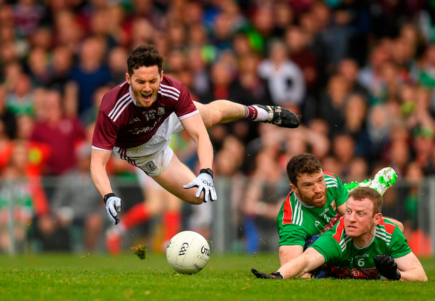 Galway's Ian Burke (l) is fouled by Mayo's Chris Barrett (c) which resulted in a penalty during their All-Ireland SFC Round 4 match at the LIT Gaelic Grounds. Photo: Sportsfile