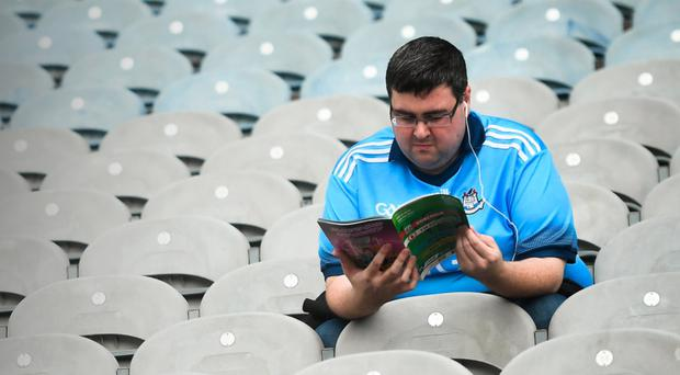 LACK OF ATMOSPHERE: A lone Dublin supporter inspects the programme prior to the All-Ireland SFC quarter-final Group 2 Phase 2 match at Croke Park on Saturday. Photo by David Fitzgerald/Sportsfile