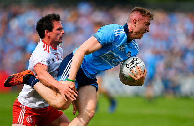 ON THE BALL: Dublin forward Paddy Small wins possession ahead of Tyrone's Aidan McCrory. Pic: Sportsfile