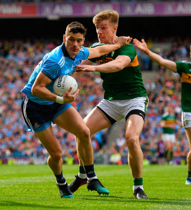 Dublin's Diarmuid Connolly is tackled by Kerry's Tommy Walsh during the All-Ireland SFC final last Sunday. Both players are survivors of the infamous 'startled earwigs' match from 2009