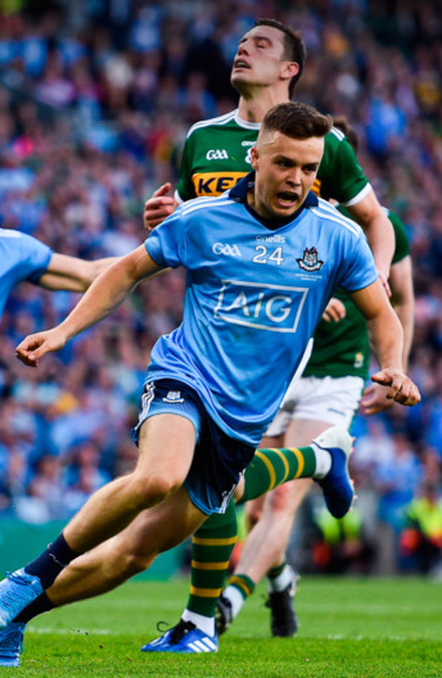 Dublin's Eoin Murchan celebrates after scoring a goal, seconds into the second half, as Kerry's David Moran looks on during the All-Ireland SFC final replay at Croke Park on Saturday. Photo: Sportsfile