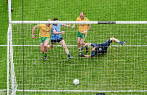 Colm McFadden of Donegal scores his side's third goal past Dublin goalkeeper Stephen Cluxton during the 2014 All-Ireland SFC semi-final at Croke Park