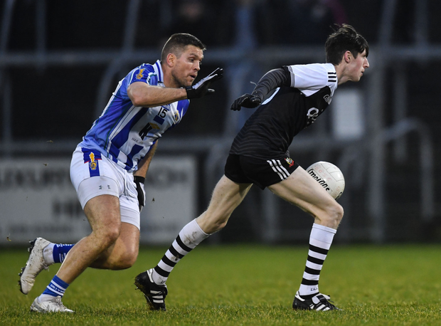 Conal Keaney chases after Eugene Branagan in the All-Ireland club semi-final last Saturday