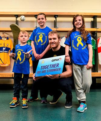 Tipperary hurler Noel McGrath with children, from left, Oran, Ciara and Shona Murray, all from Letterkenny, Co. Donegal, at the launch of a new charity partnership between the GPA and Childhood Cancer Foundation.