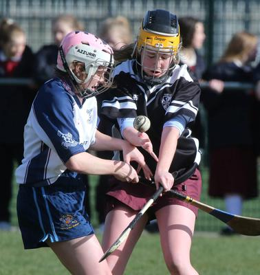 Aoife Wade, Dominican tries to clear the ball as Niamh Horan, Loreto blocks. Picture: Colin O'Riordan