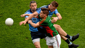 Mayo's Lee Keegan bumps into Dublin's Alan Brogan (left) and Paul Flynn during the 2015 All-Ireland SFC semi-final in Croke Park. Photo: Sportsfile