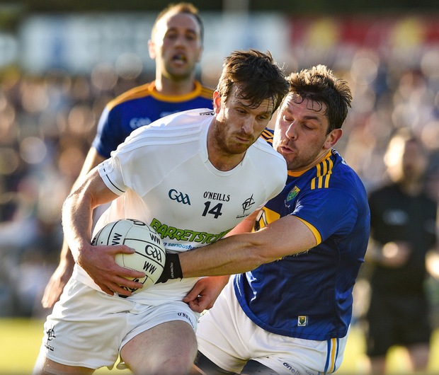 Paddy Brophy of Kildare in action against Shane Mooney of Wicklow