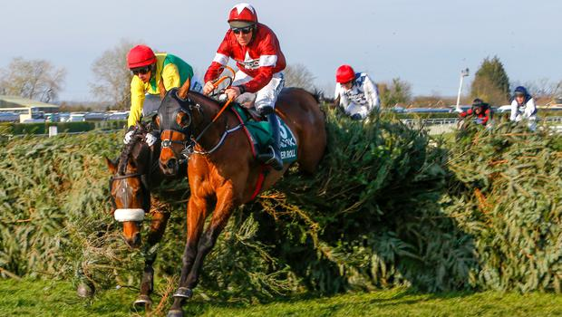 Tiger Roll, with Davy Russell on board, on the way to winning The Randox Health Grand National Handicap Chase at Aintree last April