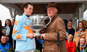 Patrick Mullins and Willie Mullins with the cup after winning the BoyleSports Champion Steeplechase on Un De Sceaux at Punchestown Racecourse in Naas, Co. Kildare. Photo: Matt Browne/Sportsfile