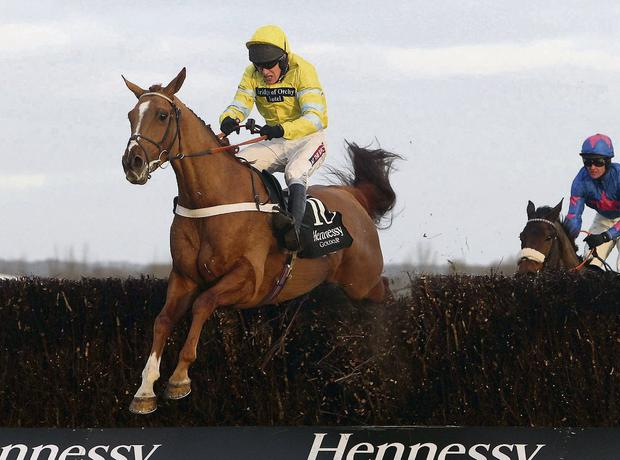 Triolo D' Alene (left) ridden by Barry Geraghty beats Rocky Creek ridden by Darly Jacob (right) over the last fence to win the Hennessy Gold Cup Steeple Chase. Picture: Steve Parsons/PA Wire