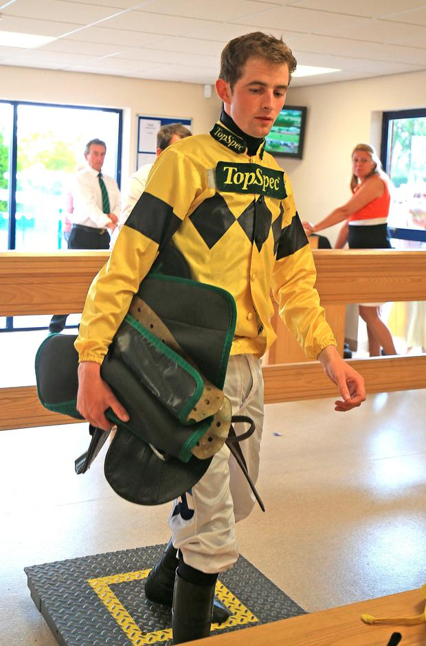 Jockey Brian Toomey weighs in at Southwell Racecourse, Nottinghamshire. PRESS ASSOCIATION Photo. Picture date: Sunday July 12, 2015. See PA story RACING Southwell. Photo credit should read: Nigel French/PA Wire