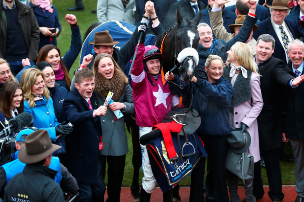 Bryan Cooper riding Don Cossack celebrates victory after winning the Cheltenham Gold Cup with trainer Gordon Elliott and owner Michael O'Leary. Photo: Getty