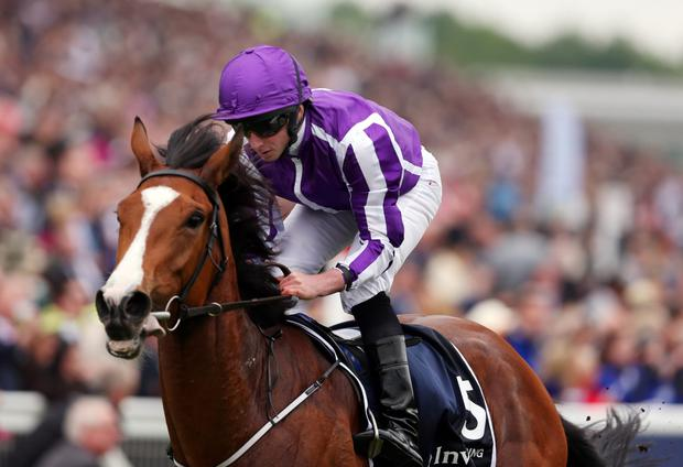 Minding and Ryan Moore winning the Oaks at Epsom. Photo: Reuters