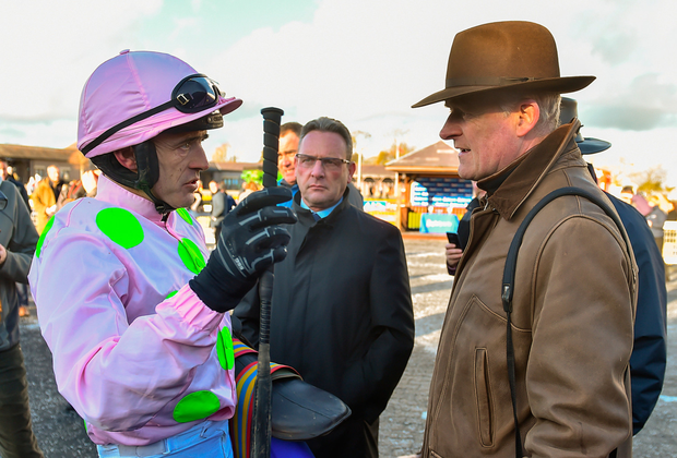Jockey Ruby Walsh and trainer Willie Mullins deep in discussion after Douvan's win at Punchestown Picture: Sportsfile