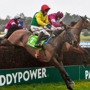 Sizing John, left, with Robbie Power up, jump the last ahead of Don Poli, with David Mullins up, during the Stan James Irish Gold Cup on Sizing John at Leopardstown