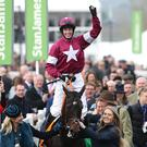 Jockey Bryan Cooper celebrates after Apple's Jade won the OLBG Mares Hurdle Race at Cheltenham. Photo: Damien Eagers / INM