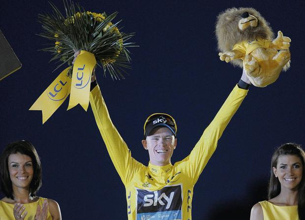 Sky's Chris Froome celebrating on the podium after winning The 2013 Tour de France in Paris. Picture: Tim Ireland/PA Wire.