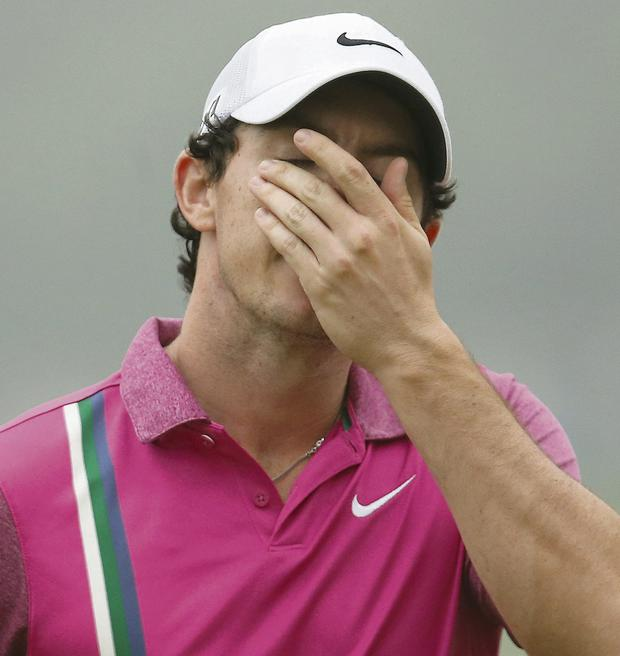 Rory McIlroy of Northern Ireland wipes his face after finishing the HSBC Champions golf tournament at the Sheshan International Golf Club in Shanghai. Photo: AP/Eugene Hoshiko