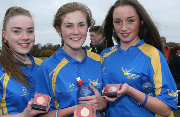 Larkin CC's (l-r) Roslyn O'Mahony (bronze), Lauren Fitzgerald (gold) and Jennifer Corrigan (silver) after the junior girls 1000m race. Picture: Steve Perry