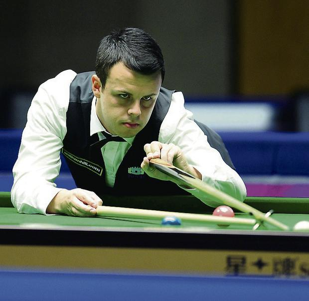 John Astley in action during his first round match against Ken Doherty. Picture credit: Anna Gowthorpe/PA Wire