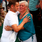 Marcus Willis celebrate with his mother after his win on Court 17 at Wimbledon. Pic: Getty Images