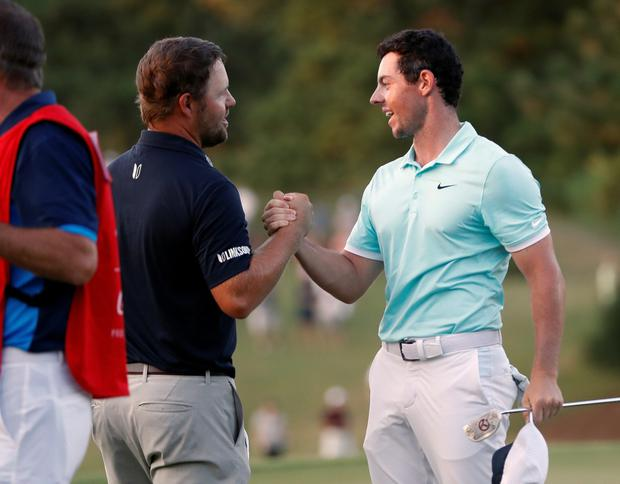 Rory McIlroy shakes hands with Ryan Moore at the Tour Championship.The two will be on opposite sides this weekend at Hazeltine.