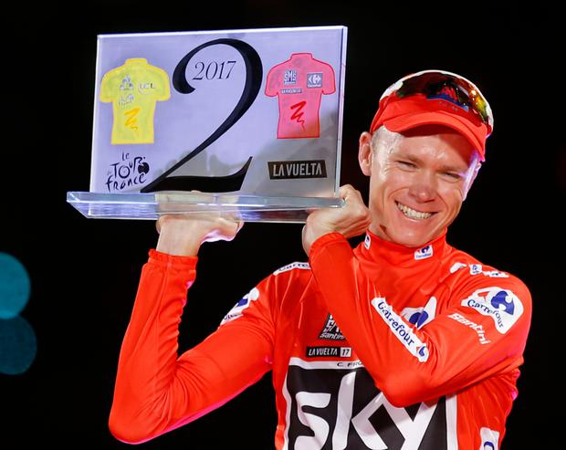 Britain's Chris Froome celebrates on podium after winning the Spanish Vuelta cycling race, in Madrid.