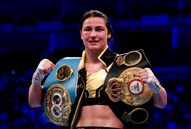 Katie Taylor displays her WBA & IBF World Lightweight Championship belts. Photo: SPORTSFILE