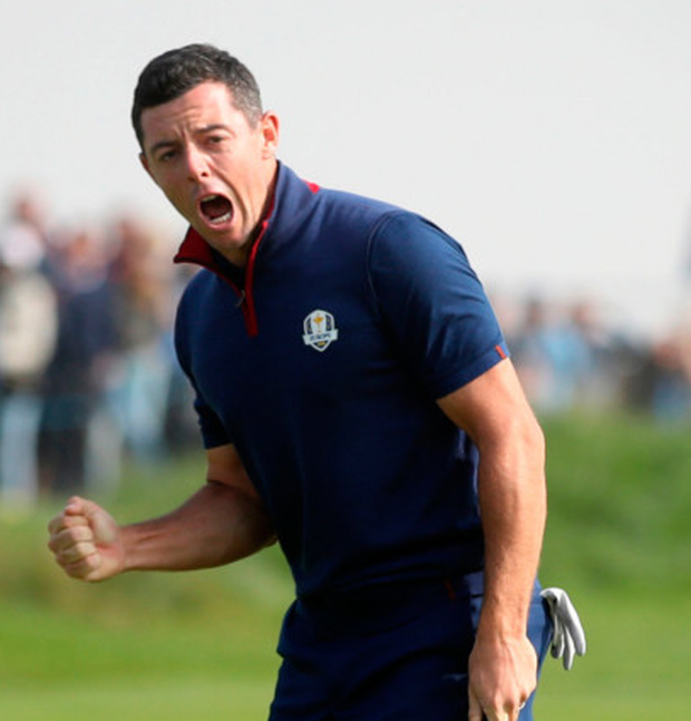 Hole lot of love: Rory McIlroy pumps his fist after sinking a putt during yesterday's foursomes