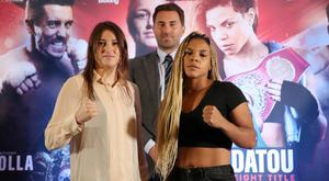 Christina Linardatou (r) and Katie Taylor pose as promoter Eddie Hearn looks on as they promote their fight in Manchester in November