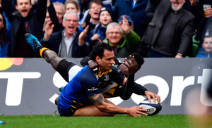 Isa Nacewa scores Leinster's first try despite the tackle of Christian Wade of Wasps at the Aviva Stadium on Saturday