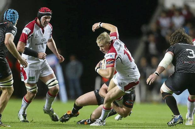 HELD: Ulster's Luke Marshall is tackled by Ryan Bevington of the Ospreys during their PRO12 game at Liberty Stadium.