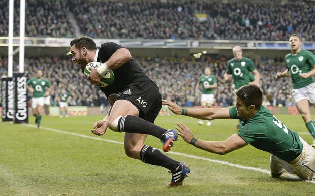 New Zealand's Ryan Crotty goes over for his side's final try despite the tackle of Ireland's Conor Murray. Picture credit: Stephen McCarthy / SPORTSFILE