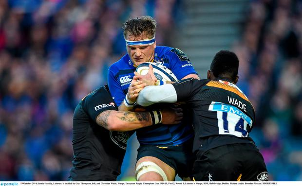 19 October 2014; Jamie Heaslip, Leinster, is tackled by Guy Thompson, left, and Christian Wade, Wasps. European Rugby Champions Cup 2014/15, Pool 2, Round 1, Leinster v Wasps, RDS, Ballsbridge, Dublin. Picture credit: Brendan Moran / SPORTSFILE