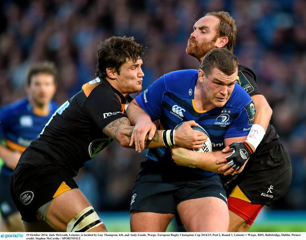 9 October 2014; Jack McGrath, Leinster, is tackled by Guy Thompson, left, and Andy Goode, Wasps. European Rugby Champions Cup 2014/15, Pool 2, Round 1, Leinster v Wasps. RDS, Ballsbridge, Dublin.