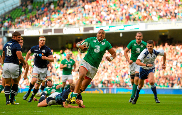 Ireland's Simon Zebo slips the tackle of Scotland's Greig Tonks on his way to scoring his side's third try during Saturday's match at the Aviva Stadium