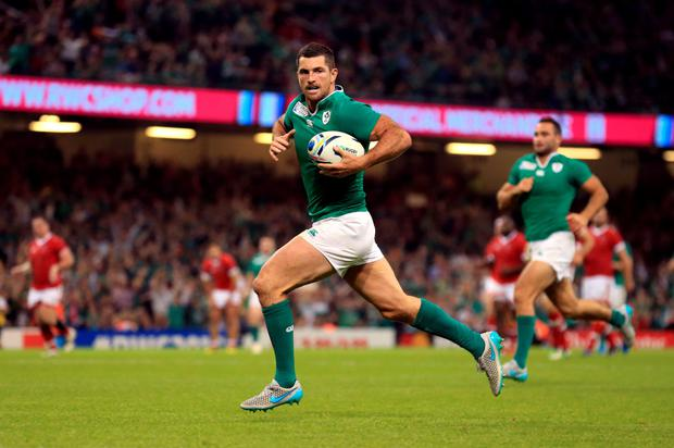 Ireland's Rob Kearney races clear to score his side's seventh try of the game during the Rugby World Cup match against Canada at the Millennium Stadium