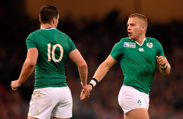 Ireland's Ian Madigan (r) and Jonathan Sexton