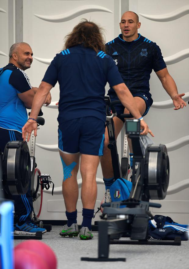 Italy's back row Sergio Parisse (R) and Italy's prop Martin Castrogiovanni take part in a team training session at Cobham RFC, west of London, on September 30, 2015