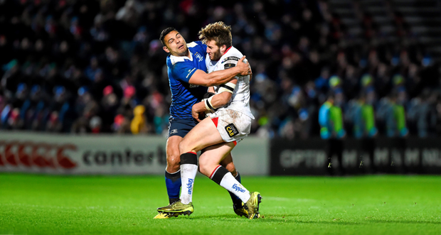 Leinster's Ben Te'o wraps up Ulster's Stuart McCloskey at the RDS Arena, Ballsbridge.