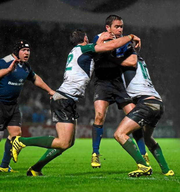 Eoin Reddan runs into the Connacht defence during the Guinness PRO12 match at the RDS. Pics: Sportsfile