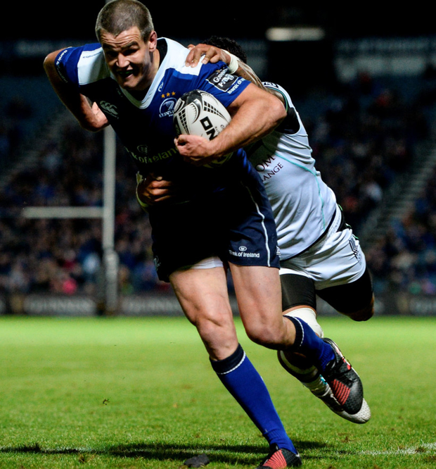 Leinster fly-half Johnny Sexton gets over for a first half try against the Ospreys at the RDS last night