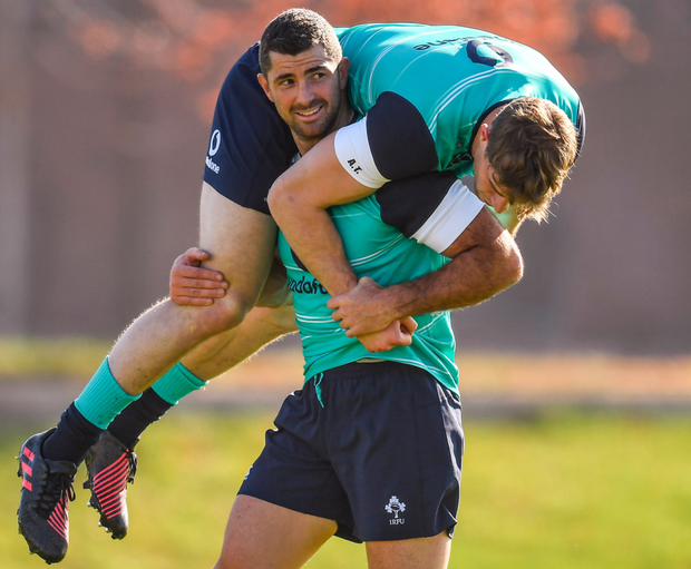 Rob Kearney carries Andrew Trimble during squad training at University of Illinois, Chicago