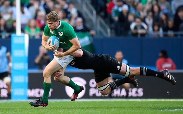 Andrew Trimble is tackled by All Black Kieran Read during the game at Soldier Field. Photo: Sportsfile